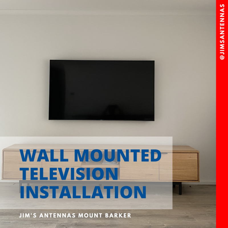 A wall mounted 65″ TV in Belair.