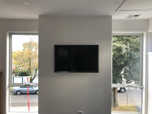 Lounge with centre Wall Mounted TV by Jim's Antennas